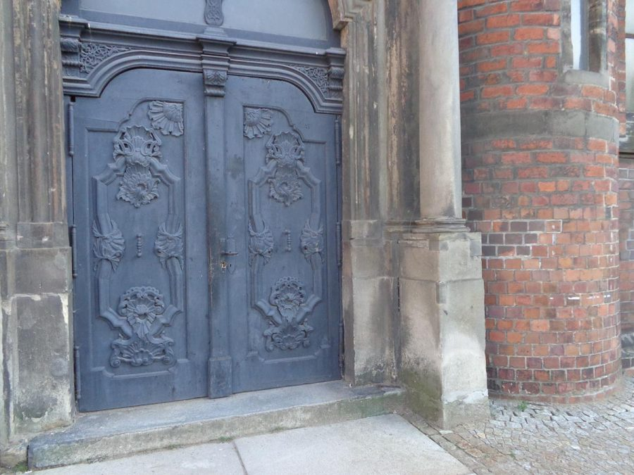 Outside a side doorway into St. Mary Magdalene Church. This large brick-built church dates from the 13th century. During the Reformation (1523) it became a Lutheran Protestant church, but today is Polish Catholic. In style it is a mixture of Gothic and Romanesque. It was badly damaged during World War Two and has since been restored.