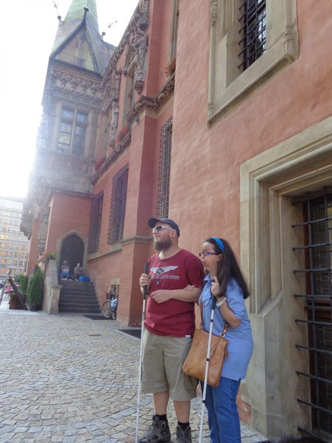 Tony and Tatiana in front of the Old Town Hall. Part of the south facade can be seen immediately behind. The Old Town Hall was mostly built between the 13th and mid-16th centuries. It is today one of the city's main landmarks.
