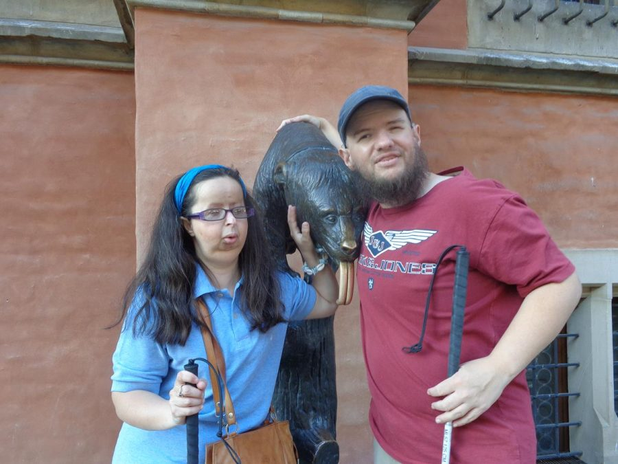 Tony and Tatiana touching the bronze statue of a bear that stands by the south wall of the Old Town Hall. The bear is sitting on a log with its tongue sticking out. It is apparently a fountain with water flowing from the thirsty bear's mouth to a pool below, but this appears to be turned off in the photo. The original statue was created by Ernst Moritz Geyger in 1902. This was lost during World War Two and this replacement was unveiled in 1998.