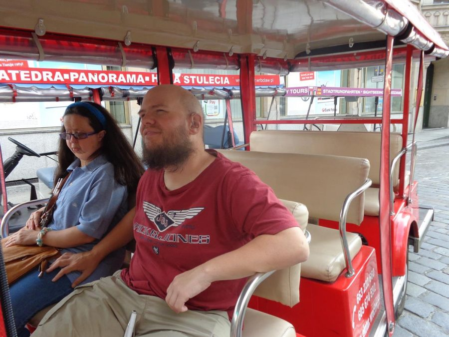 Closer view of Tatiana and Tony inside the red minibus.