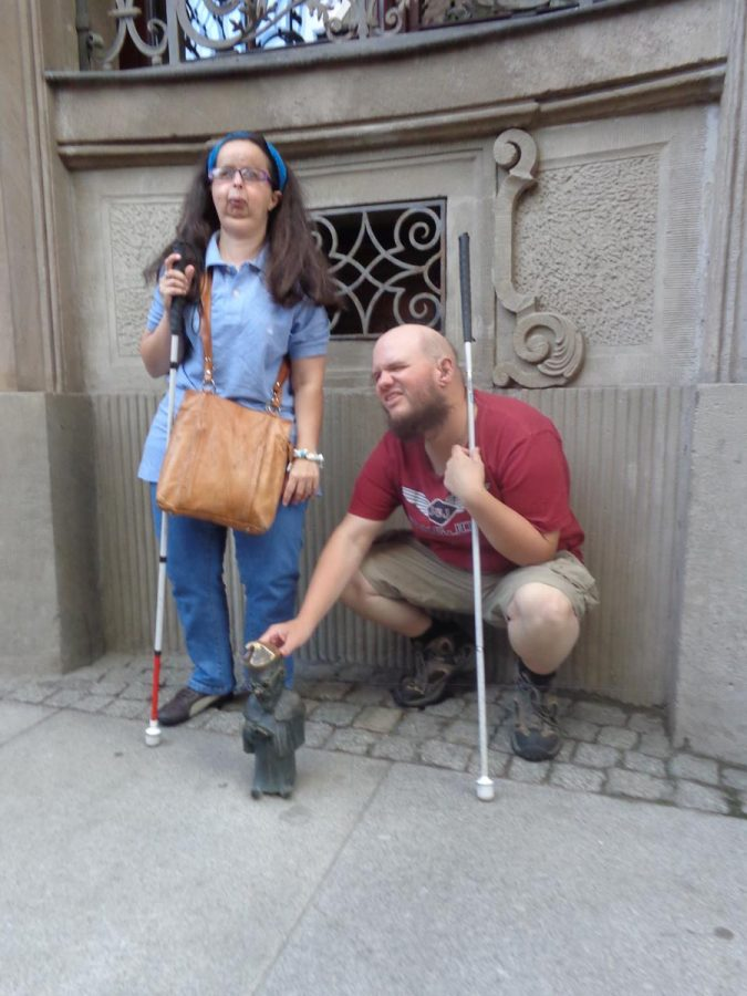 Tony touching a bronze dwarf. Over 600 /1000 of these small bronze figurines can be found across the city, on pavements, walls and lamp posts. Seeking out these dwarfs (krasnale) is an interesting and fun way to explore the city. Maps are available to help in attempting to locate many of the dwarfs and can be obtained from various outlets in the 'old town' and also from the internet.