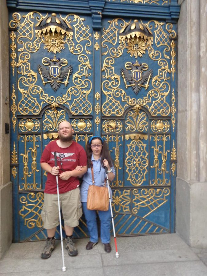 Tatiana and Tony in front of an ornate doorway that is part of Wroclaw University. The doors are blue with embossed gold decoration. The University of Wrocklaw (Uniwersytet Wroclawski) is a public research university in Wroclaw. It was founded in 1945, replacing the previous German University of Breslau that, alongside Austrian-Hungarian ownership, roughly dates back to 1702.Tatiana and Tony in front of an ornate doorway that is part of Wrocław University. The doors are blue with embossed gold decoration. The University of Wrocław (Uniwersytet Wroclawski) is a public research university in Wrocław. It was founded in 1945, replacing the previous German University of Breslau that, alongside Austrian-Hungarian ownership, roughly dates back to 1702.