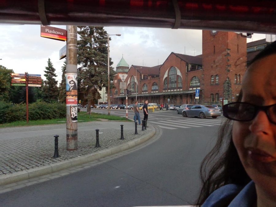 Again riding in the electric minibus with Wrocław Market Hall visible behind. The Market Hall was built between 1906 and 1908 when the city was part of the German Empire. Today the hall still contains hundreds of stalls selling fresh food and flowers.