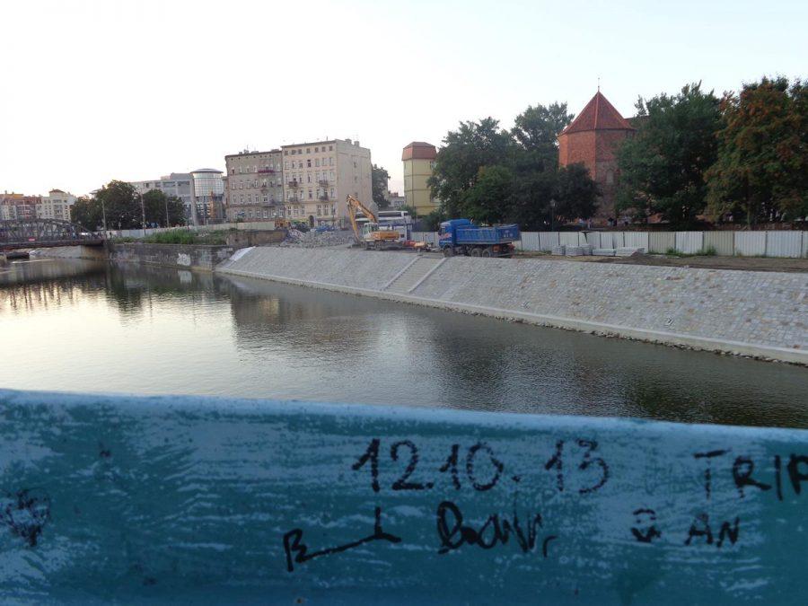 View from Tumski Bridge along a branch of the Oder River towards another steel bridge crossing from  Wyspa Młyńska (Mill Island) to Ostrów Tumski (Cathedral Island).