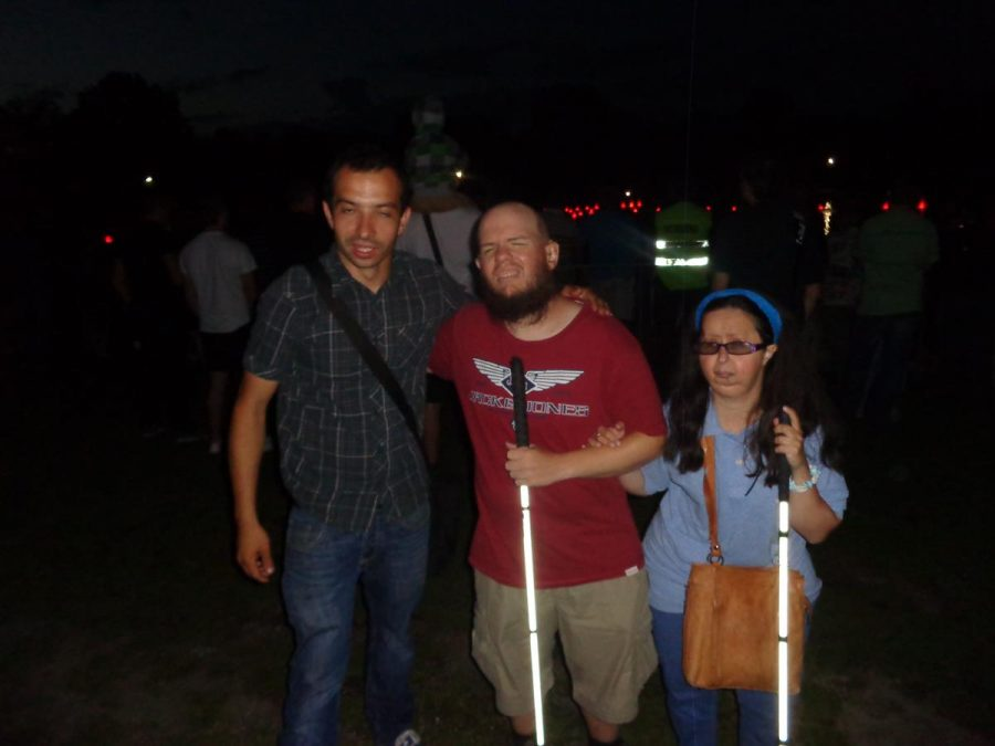 Tatiana, Tony and a Polish guy at Wroclaw Exhibition Grounds during the evening. A large ornamental pond is mostly hidden in the darkness behind. The pond contains a musical fountain and light show built in 2009. It is one of the largest operating fountains in Europe with over 300 jets. The Polish guy was our minibus driver and guide.