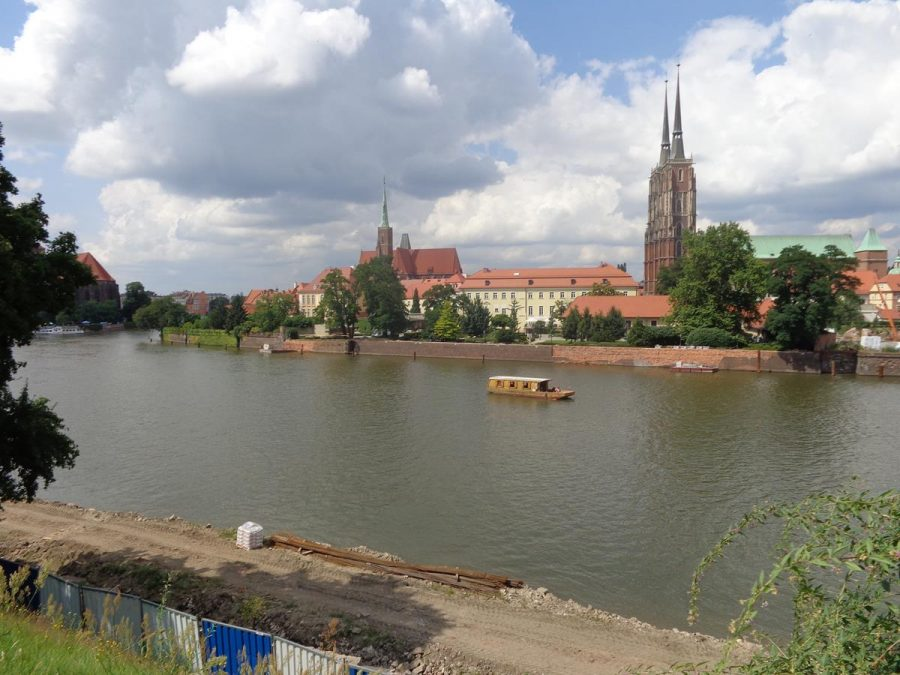 View across the Oder River with a good view of the towers and spires of Wrocław Cathedral and the Collegiate Church of the Holy Cross and St Bartholomew on the opposite bank.