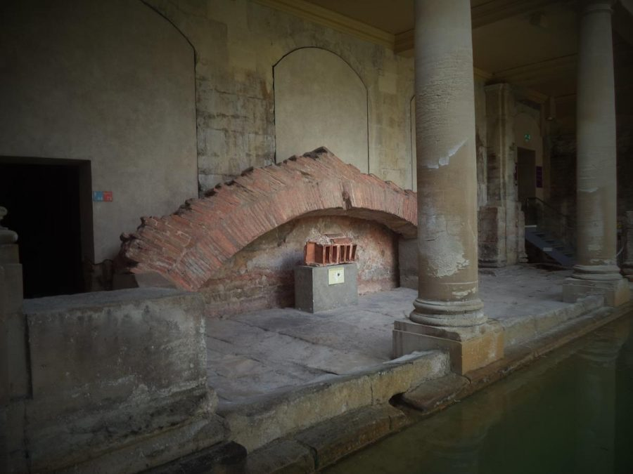 A Roman brick arch at one end of the Great Bath. This is the remains of one of the arches that originally held up the large roof above the Great Pool.