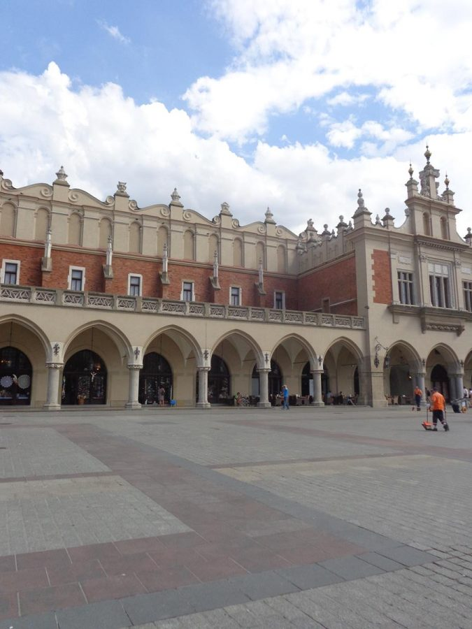 Another view of the Cloth Hall. The parapets along the roof are topped with decorative carved gargoyle masks.