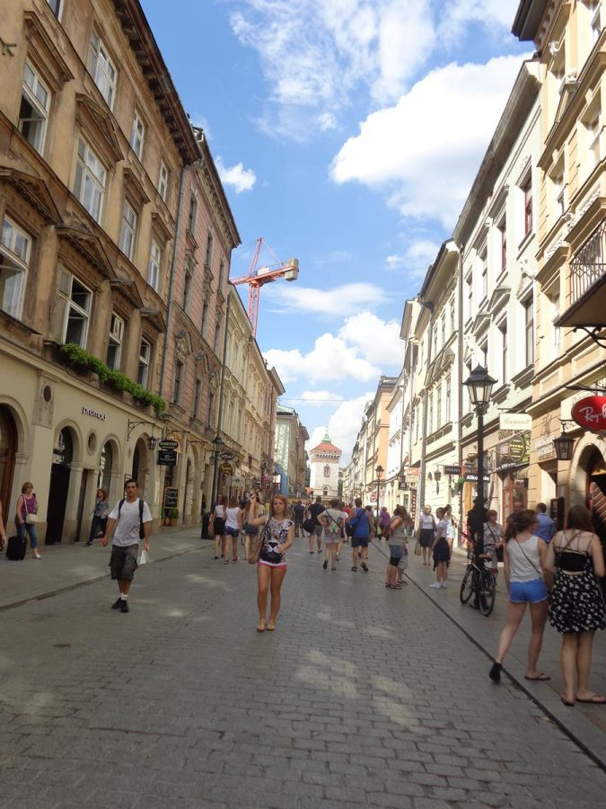 Looking along ulica Florianska (Florianska Street orSt. Florian's Street), a busy and important pedestrian street that runs roughly north from Main Square. This street is part of the historic grid layout of the Old Town, which was drawn up in 1257, after the destruction of the city during theTatar invasionsof 1241. St. Florian's Gate is just visible at the far end. This 14th century rectangular stone tower is part of the city's historic fortifications.