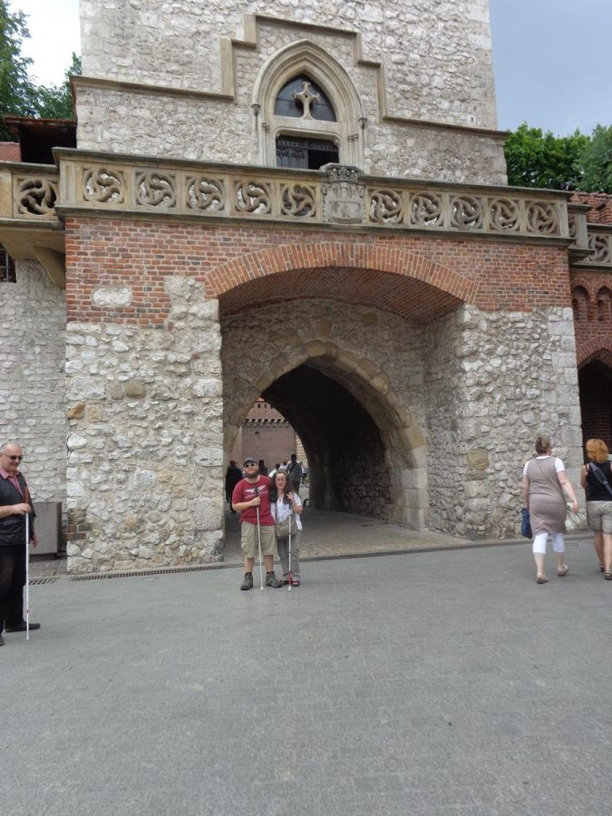 Tony and Tatiana in front of St. Florian's Gate. The arched passageway passing through the centre of the tower is behind them.