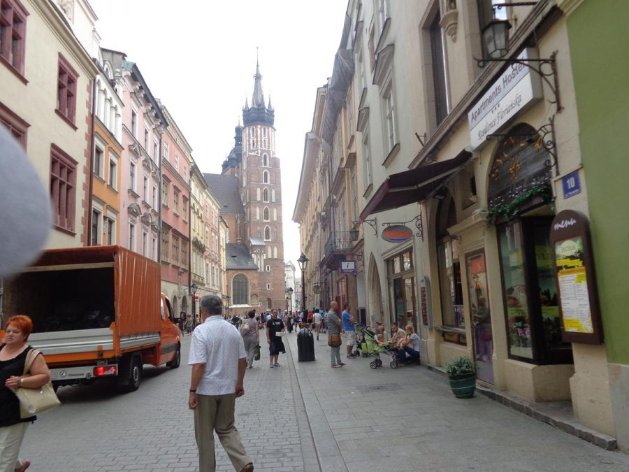 View along ulica Florianska with the north tower of St. Mary's Basilica standing prominently at the far end. The height of the north tower was raised in the 15th century so that it could serve as a watch tower over the city.