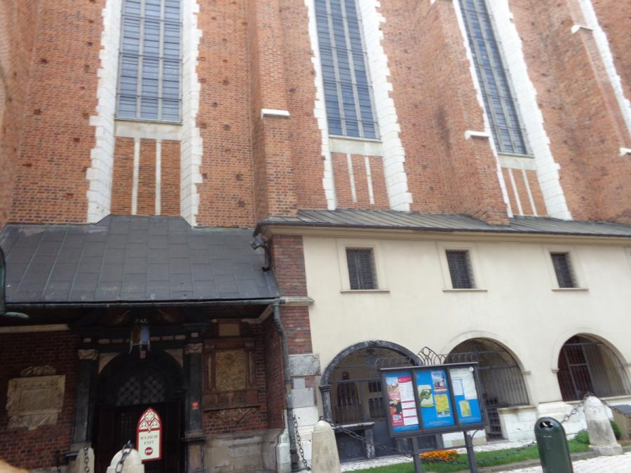 Part of the south-east façade of St. Mary's Basilica. A side entrance with a doorway and porch and tall narrow Gothic windows above.