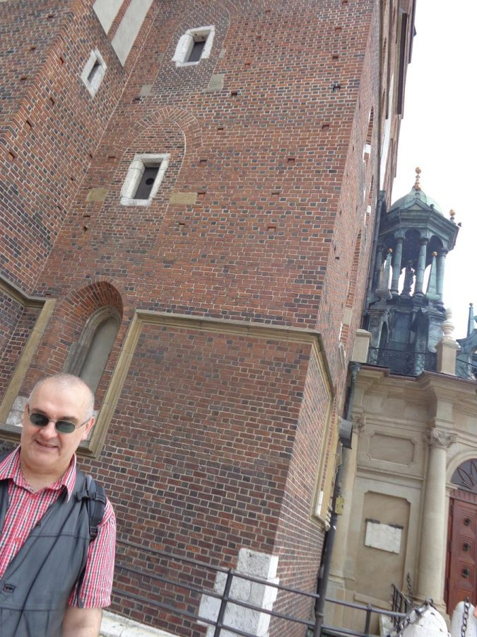 At the foot of the north tower of St. Mary's Basilica. Tony and Tatiana's friend Andrej in the foreground. He is totally blind and is using a white cane.