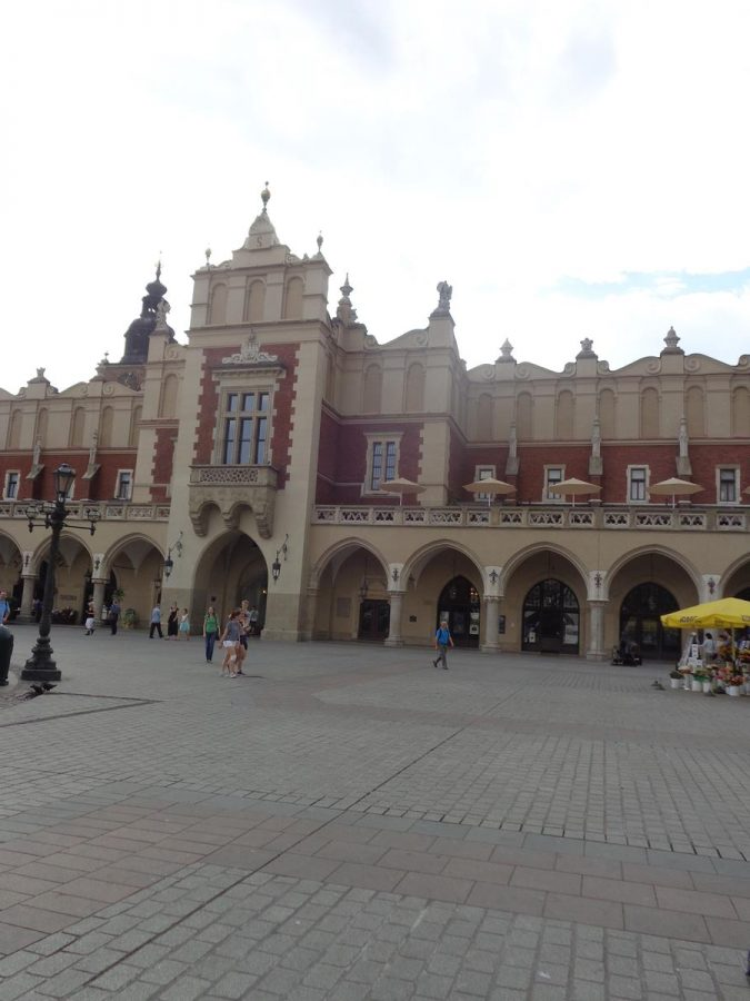 The east façade of the Cloth Hall. The building is rectangular in shape: its dimensions are about 110 metres (361 feet) long and 36 metres (118 feet) wide. Today the Cloth Hall contains many small shops and stalls selling food, crafts and souvenirs. The upper floor houses the Sukiennice Museum, which displays 19th-century Polish painting and sculpture.