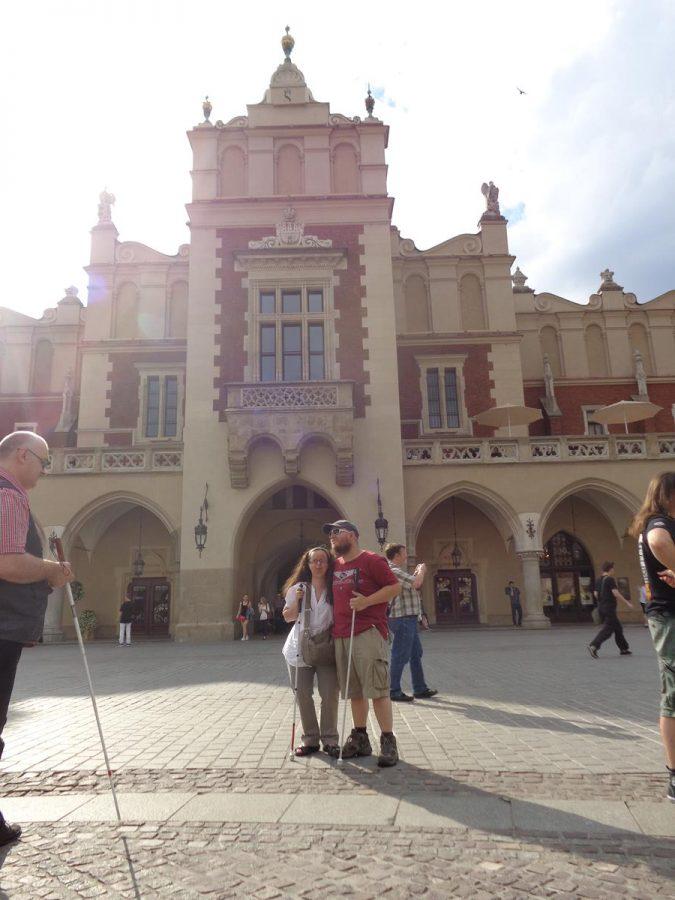 Tatiana and Tony outside an entrance to the Cloth Hall.