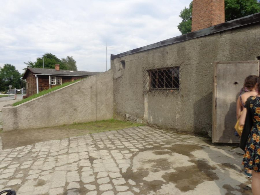 Outside the crematorium and gas chamber at Auschwitz I. Tens of thousands of people were killed in the gas chamber here during 1941 and 1942. It was possible for over 700 people to be executed at once. This gas chamber was replaced in 1942 by new gas chambers at Auschwitz II (Birkenau) camp. The concrete building has a single storey above ground and a brick chimney.
