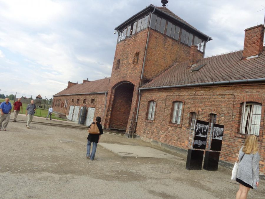The gatehouse at Auschwitz II-Birkenau camp. A train track runs through its central gateway. The track then continues directly to the gas chambers. Birkenau had 4 gas chambers.