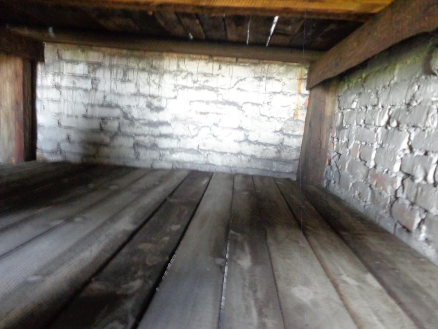 A wooden bunk bed inside one of the barrack blocks. These small bunks were designed for three people but often held many more.