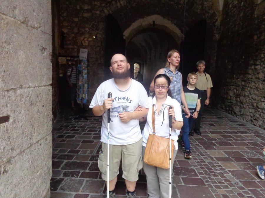 Tony and Tatiana inside a passageway leading into the main courtyard.