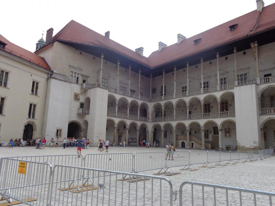 Another view of the large main courtyard of Wawel Royal Castle showing the surrounding buildings including the arcades.