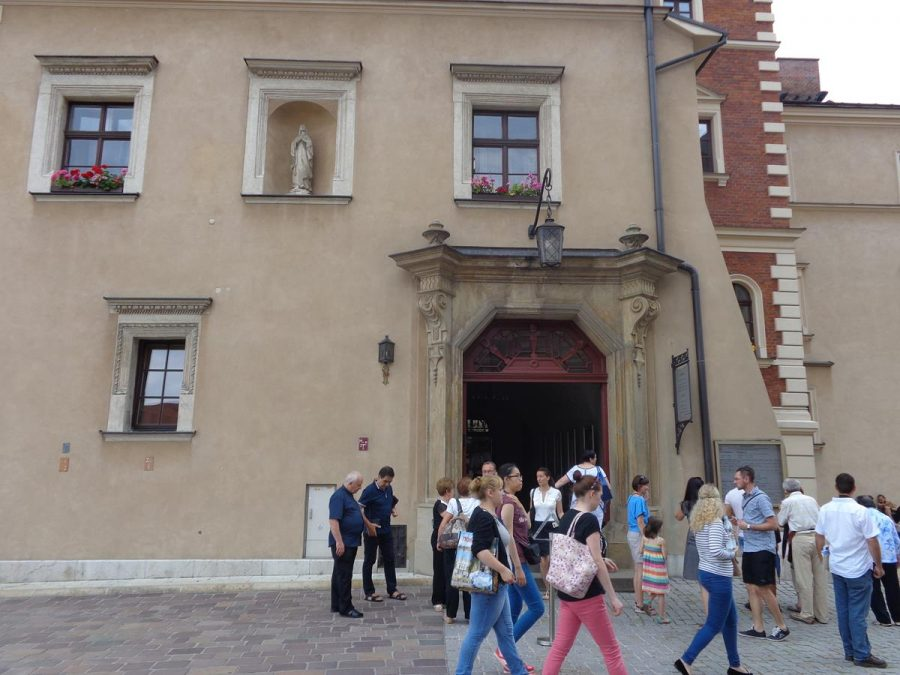 The Vicar's House located opposite Wawel Cathedral with the main entrance doorway in front. The building dates from the 15th century with many later additions. It is three storeys in height. A small statue, perhaps of the Virgin Mary, can be seen in an alcove at first floor level.