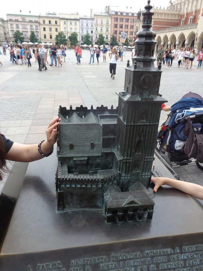 Close-up view showing a tactile model of the Town Hall Tower located in Main Square (Rynek Glówny).