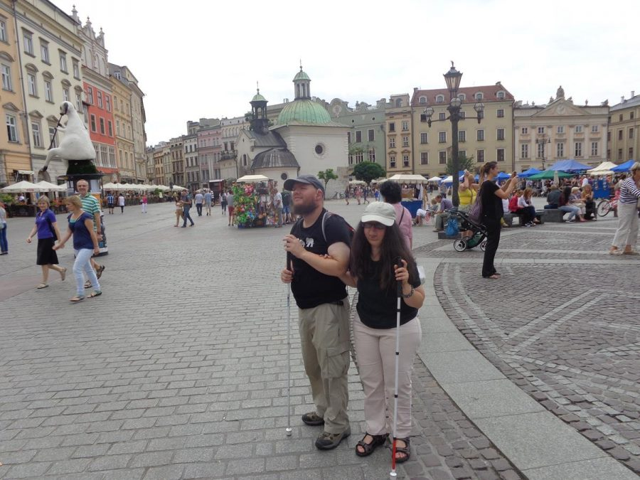 Tatiana and Tony in Main Square (Rynek Glówny). View towards the south-east corner of the square with the small 11th century Church of St. Adalbert visible.