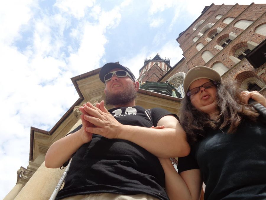 Looking up at the front façade of St. Mary's Basilica with the two towers at the top. Tony and Tatiana in the foreground.