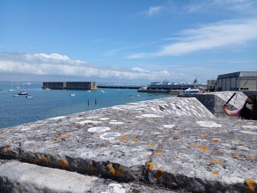 Another view of Portland Harbour and the Phoenix breakwaters from Portland Castle. Stone ramparts in the foreground.