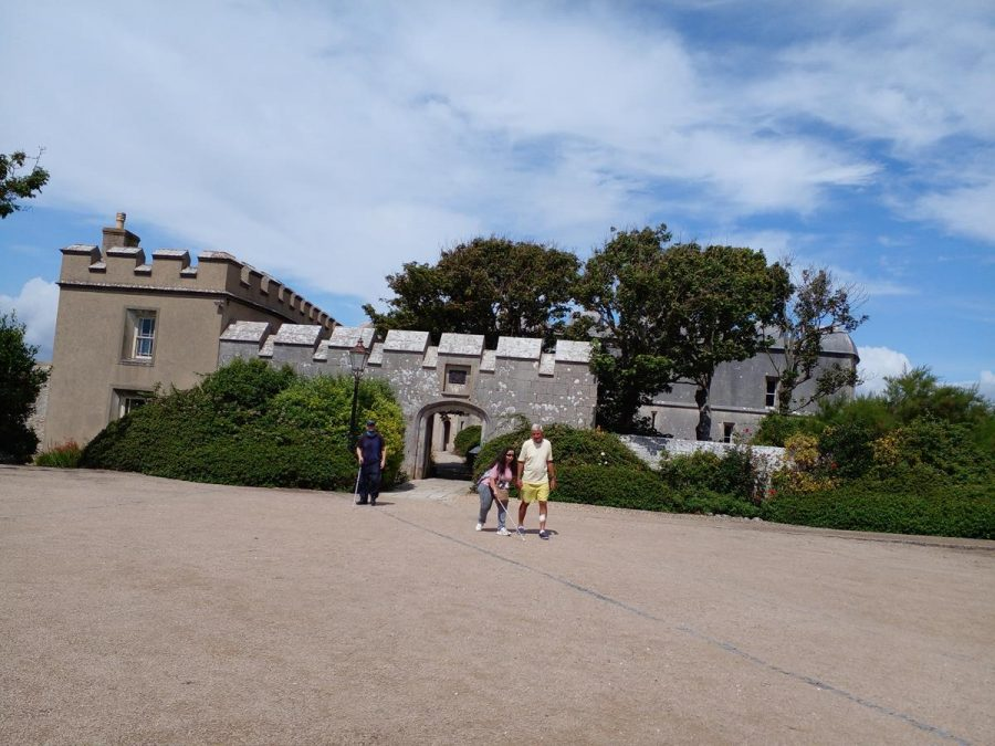 Another view of Tony, Tatiana and Spud leaving Portland Castle. The entrance gateway is behind and to the left adjoining the outer wall is the Captain's House. The Captain's House became a private residence after the end of the Napoleonic Wars in 1815 when the castle was disarmed. Today it contains the castle's ticket office, tea room and gift shop.