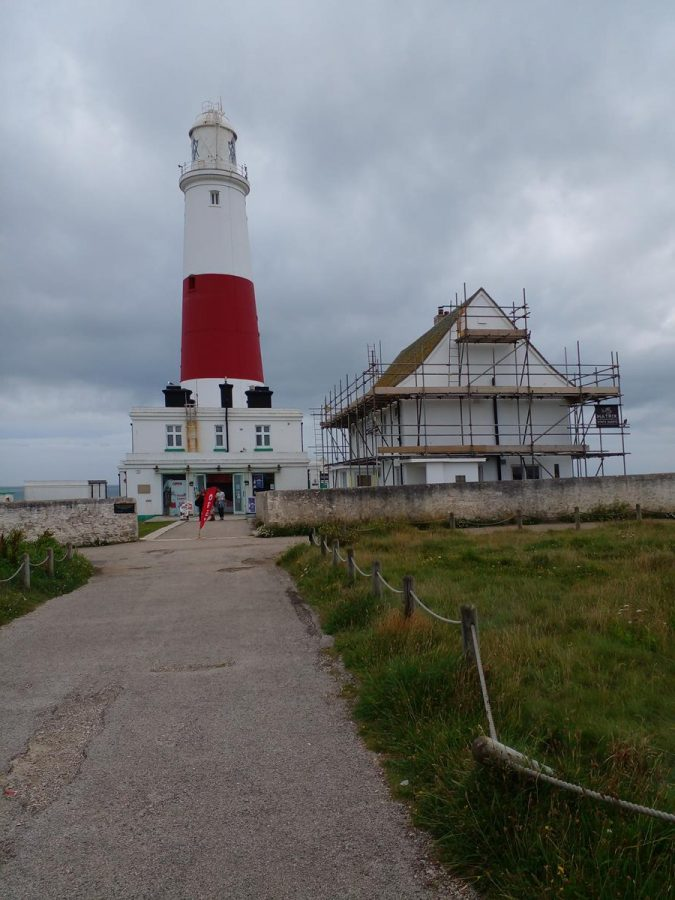 Another shot of Portland Bill Lighthouse, which is painted in distinctive white and red horizontal stripes, and stands at 41 metres (135 feet) in height. The building on the right was formerly the lighthouse keeper's quarters and is today the Visitors' Centre. As of summer 2021, the lighthouse is closed to tours, but will, hopefully, reopen sometime in the near future. When running, the tours allow visitors to climb the 153 steps to the top of the lighthouse.