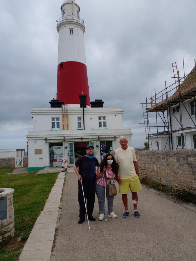 Tony, Tatiana and Spud in front of Portland Bill Lighthouse.