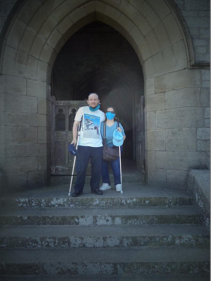 Tony and Tatiana outside the main entrance to St. Helen's Church. They are at the top of steps in front of the porch.