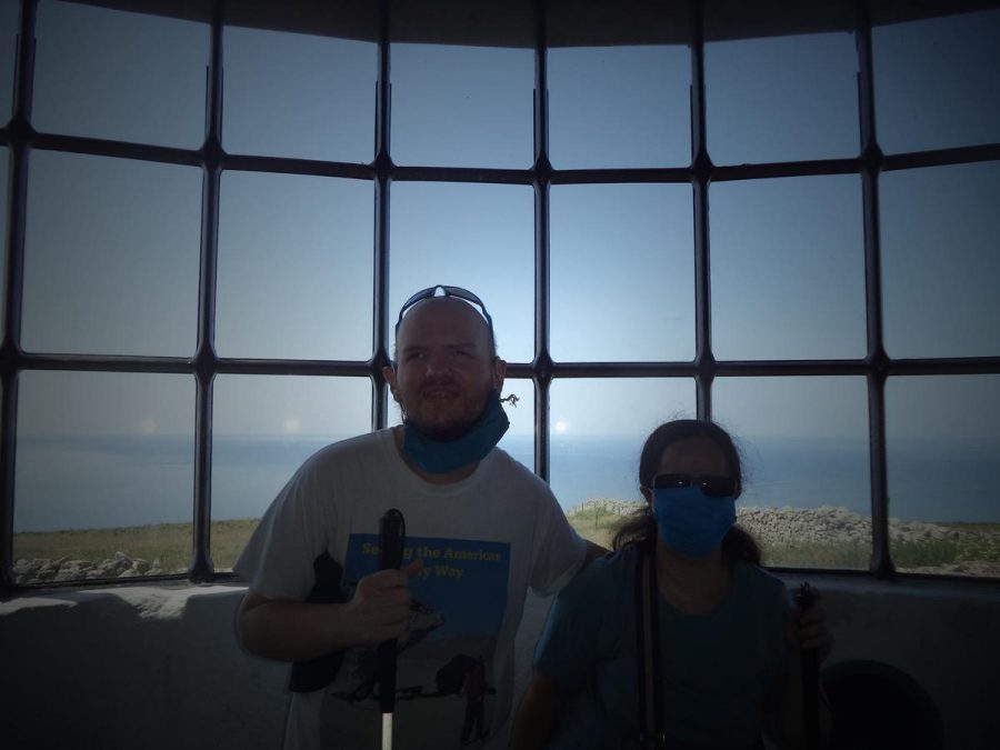 Tony and Tatiana inside Lundy Old Light, Lundy's first lighthouse constructed in 1820. The granite tower is 29 metres (95 feet) in height and it stands on Beacon Hill, which is 143 metres (469 feet) above sea level, making it the highest base for a lighthouse in Britain. The light was often obscured by fog, and to counter this problem, a Fog Signal Battery, equipped with a pair of 18-pound guns, was built about 1861. The lighthouse was deactivated in 1897 when Lundy North Lighthouse was completed. Lundy South Lighthouse was also constructed in 1897.