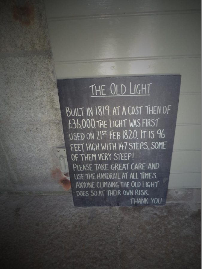 """An information board inside Lundy Old Light. Some of the text reads: """"Built in 1819 at a cost then of £36,000, the light was first used on 21st February 1820. It is 96 feet high with 147 steps, some of them very steep!"""""""