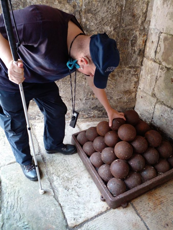 Tony feeling a pile of 17th century cannon balls on the lower gunnery platform.