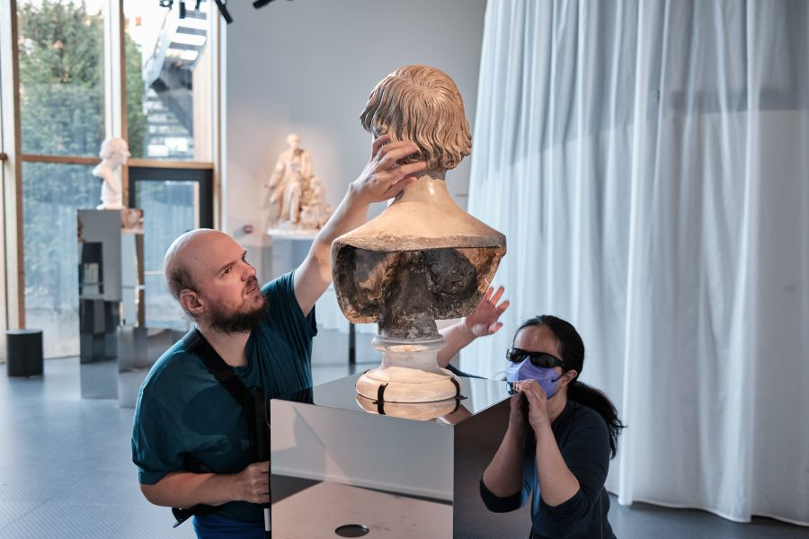 The rear of the Hans Christian Andersen bust with Tony feeling the hair and Tatiana along side.